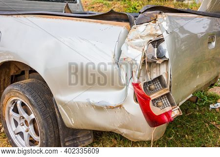 Car Accident Isolated On White Background,car From Being Bumped The Rear Lights,car Bumper Dent And