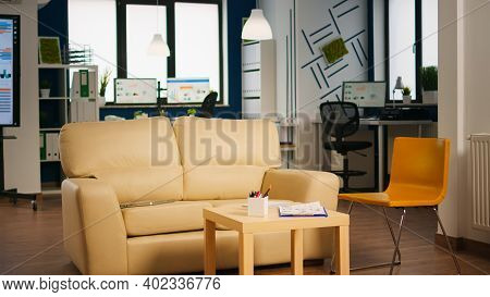 Empty Start Up Business Office With Modern Design And Confortable Couch. Financial Company With Nobo