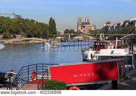 Paris, France - August 30, 2019: This Is A View Of The Sully Bridge And Notre Dame Cathedral From Th