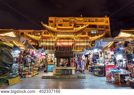 Kunming, China - Oct 2019 : Scene Of China Temple Or Pagoda With Night Market Around Jinbi Square On