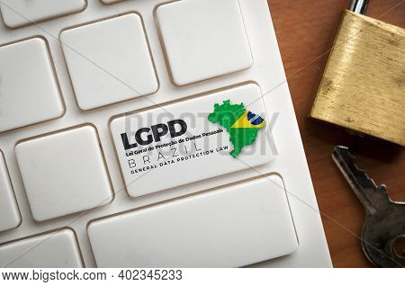 Lgpd: A White Keyboard With A Key With Text Lei Geral De Proteção De Dados Pessoais. This Law Regula