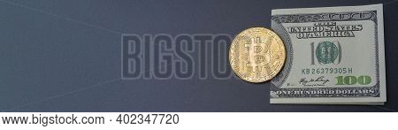One Hundred Dollars And Bitcoin On A Black Background. Cryptocurrency, Gold Bitcoin.