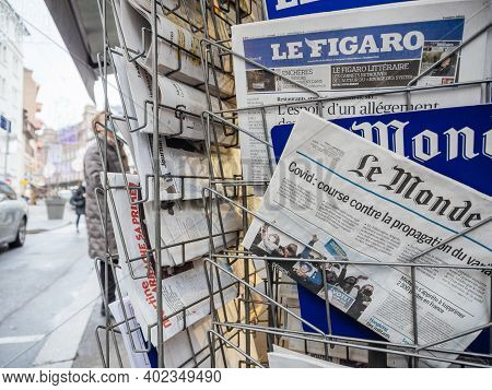 Paris, France - Jan 7, 2020: French Newspaper Le Monde On Press Kiosk Market Stall With Headlines Co