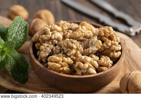 Walnuts In A Wooden Bowl. Shelled Walnuts. Healthy Organic Nuts