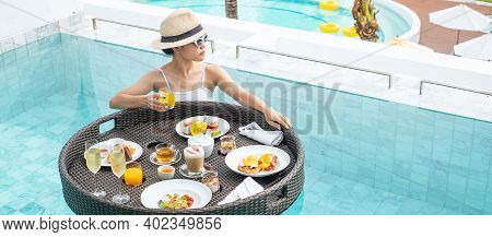 Happy Woman In White Swimsuit Having Floating Breakfast Tray In Luxury Pool Hotel, Young Female With