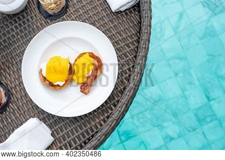 Floating Breakfast Tray In Swimming Pool At Luxury Hotel Or Tropical Resort Villa; Poached Egg With