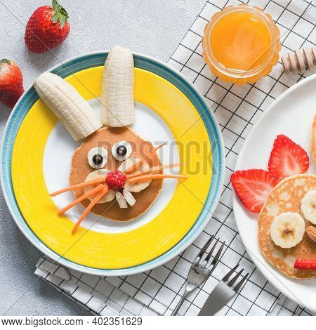 Creative Breakfast For Kids On Easter. Bunny Shaped Sweet Pancake With Fruits, Berries And Honey. Ba