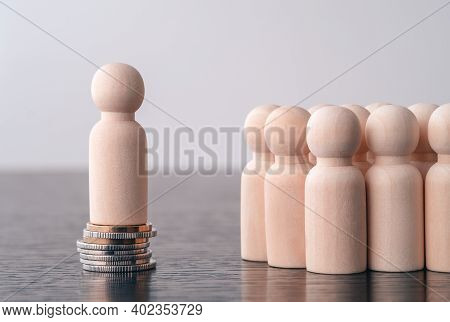 Wooden Figures Of People Standing On Money Coins Saving For Concept Investment Mutual Fund Finance A