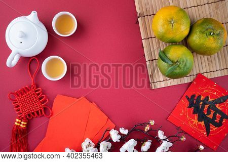 Top View Of Fresh Orange On Red Background For Chinese Lunar New Year.