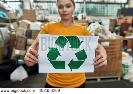 Selective Focus On Paper With Green Arrows Recycling Sign Held By Caucasian Girl Worker Of Waste Sta