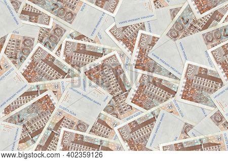 200 Croatian Kuna Bills Lies In Big Pile. Rich Life Conceptual Background. Big Amount Of Money