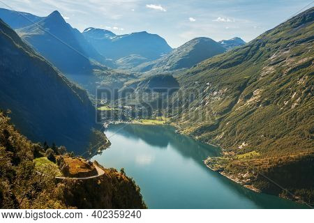 Magnificent View From The Observation Deck Of The Geirangerfjord And Town Of Geiranger, Norway