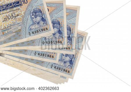 10 Tunisian Dinars Bills Lies In Small Bunch Or Pack Isolated On White. Mockup With Copy Space. Busi