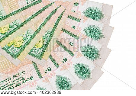 10 Sri Lankan Rupees Bills Lies Isolated On White Background With Copy Space Stacked In Fan Shape Cl