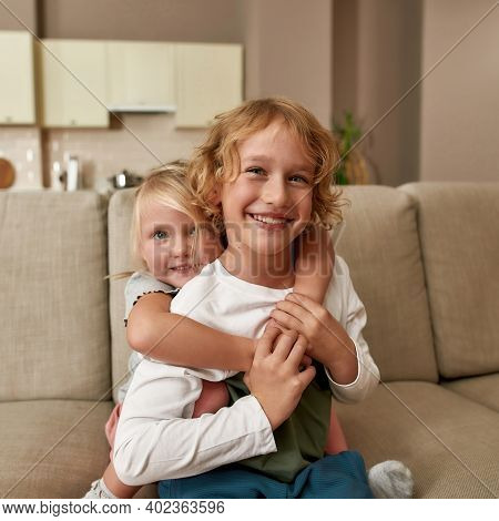 Best Friends. Portrait Of Happy Siblings, Little Boy And Girl Smiling At Camera, Embracing Each Othe