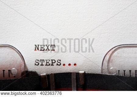 Next steps phrase written with a typewriter.