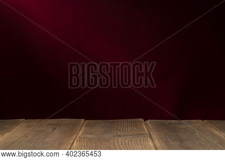 Wooden Board Empty Table In Front Of A Blurred Background. Perspective Brown Wood With A Blurry Mult
