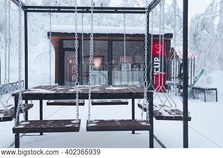 Perm Krai, Russia - January 02, 2021: Picnic Table And Small Coffee Shop On Top Of A Mountain In Win