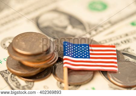 Stack Of Coins With Usa America Flag On White Background. Flag On Dollar Banknotes.