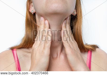 Woman With Throat Sore Is Holding Her Aching Throat - Body Pain Concept