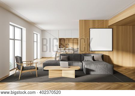 Interior Of Modern Living Room With White And Wooden Walls, Wooden Floor, Comfortable Gray Sofa And