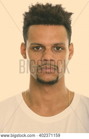 Studio Shot Of Face Of Young African Man