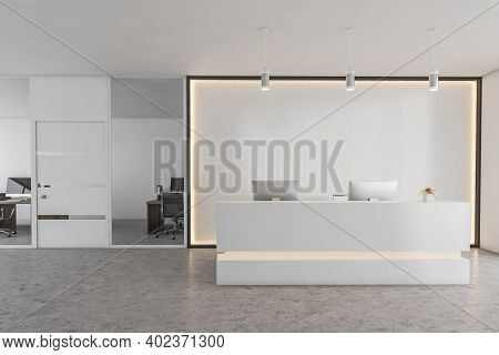 White Reception Room With Two Computers, Conference Office Room. White Wall With Backlight, Receptio