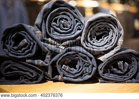 Roll Blue Denim Jeans In A Shop.