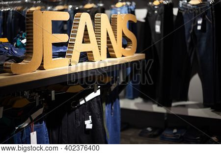 Lettering Jeans In A Shop. Concept Of Buy, Sell, Shopping And Jeans Fashion. Jeans Texture Closeup.