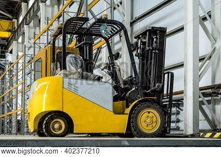 Yellow Forklift Truck In A Industrial Warehouse Building