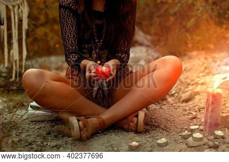 Mystical Witch Woman With Candles In Her Hands Performs An Occult Mystical Ritual