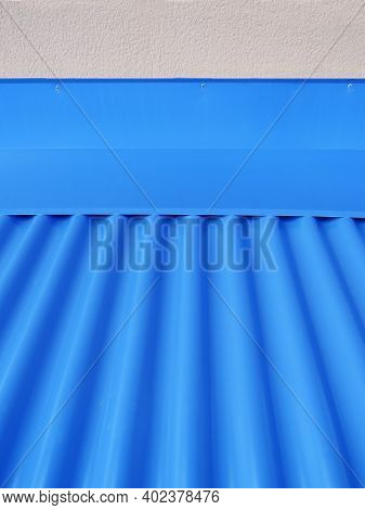 Blueish Metallic Corrugated Sheet Roof Texture. Deep Blue Profiled Sheet Panel. Corrugated Metal Roo