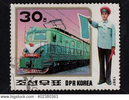 Dpr Korea - Circa 1987: Post Stamps Printed In Dpr Korea In 1987 And Dedicated Electric Locomotives