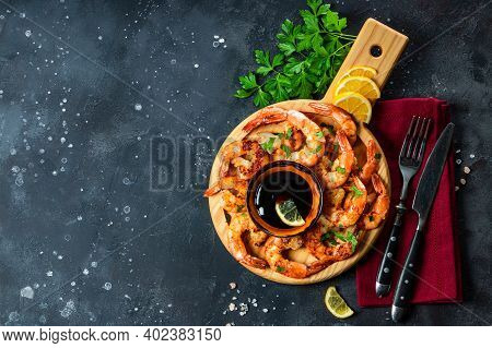 Fried Shrimps With Unagi Sauce On A Round Board, Top View, Free Space For Text