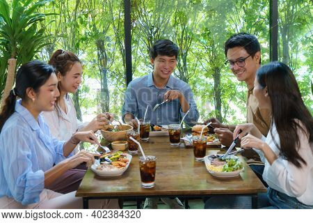 Happy Asian Friend Eating Food At Restaurant. Group Friend Cheerful Mates Laughing Enjoying Meal Hav