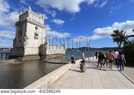 Lisbon, Portugal - June 5, 2018: People Visit Torre De Belem Fortification On Tagus River In Lisbon,