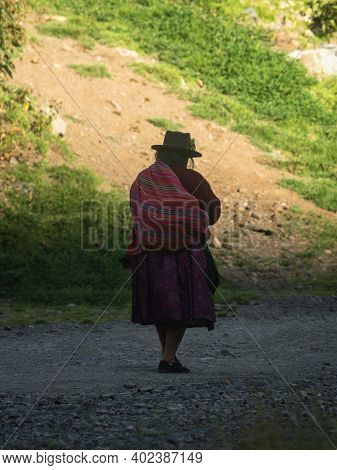 Elderly Indigenous Woman In Traditional Clothes Dress Costume On Cordillera Huayhuash Circuit Andes