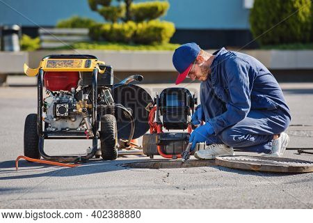 Plumber Prepares To Fix The Problem In The Sewer With Portable Camera For Pipe Inspection And Other