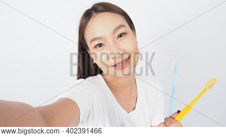 Dental Brace Sexy Girl Smile Holding Toothbrush And Looking To Camera.
