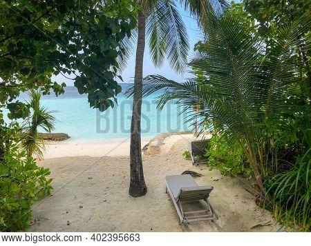 Deckchair On A Beautiful Untouched Tropical Beach. Maldives Island
