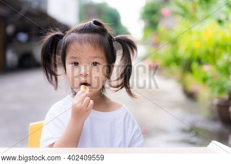 Girl Was Forced To Eat Fruit. Cute Child Eating Oranges In Front Of Her House. Parents Are Forced To