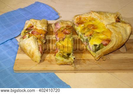 Homemade Puff Pie With Puff Pastry With Suckling, Pickles Cut Into Several Pieces.