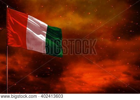 Fluttering Cote D Ivoire Flag Mockup With Blank Space For Your Data On Crimson Red Sky With Smoke Pi