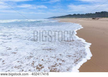 Scenic Empty Beach Ocean Sea Wave Foam Wash Closeup Walking Perspective Along Sand Shoreline Coastli