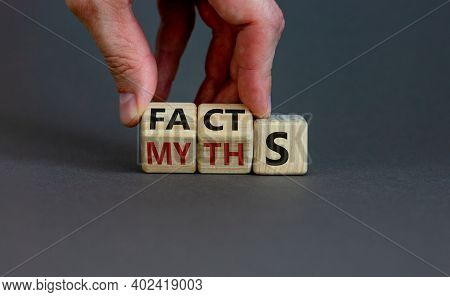 Facts Or Myths Symbol. Businessman Hand Turns Cubes And Changes The Word 'myths' To 'facts'. Beautif
