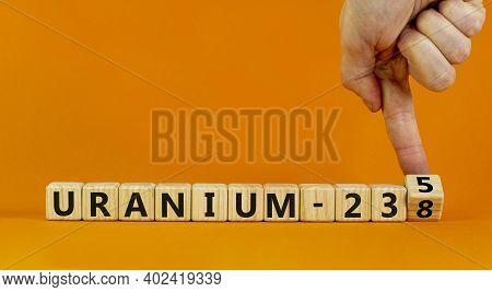 Uranium Enrichment Symbol. Hand Turns Cube And Changes Words 'uranium-238' To 'uranium-235'. Beautif