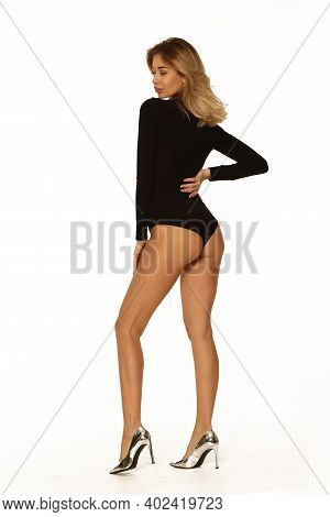 Blond Young Woman In Black Body Lingerie Full Length Portrait Isolated On White