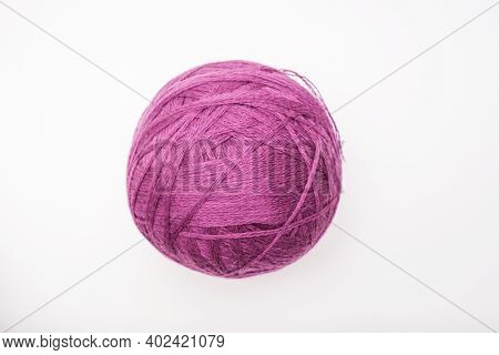 A Ball Of Purple Wool For Knitting, Crocheting Isolated On White, Violet Woolen Thread For Hobby And