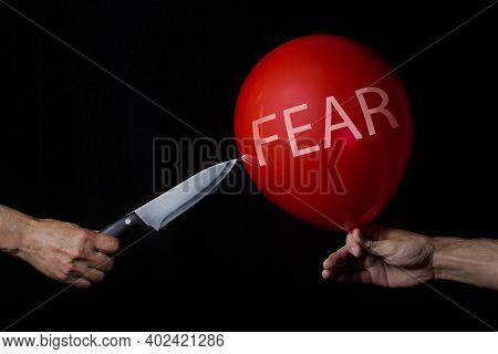 Fear. Getting Rid Of Fears. Overcoming Fear. Solution Of Problems. The Knife Pierces The Red Balloon