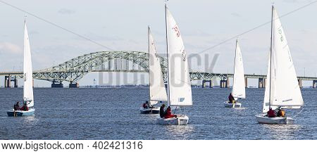 Babylon, New York, Usa - 7 December 2019: Five Two Person Sailboats In A Winter Regatta With The Gre